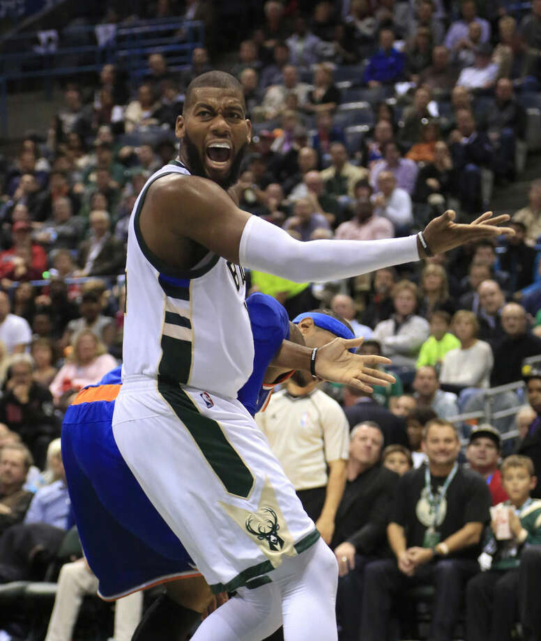 Milwaukee Bucks center Greg Monroe looks for a call while playing against the New York Knicks during the second half of a NBA basketball game Wednesday, Oct. 28, 2015, in Milwaukee. (AP Photo/Darren Hauck)