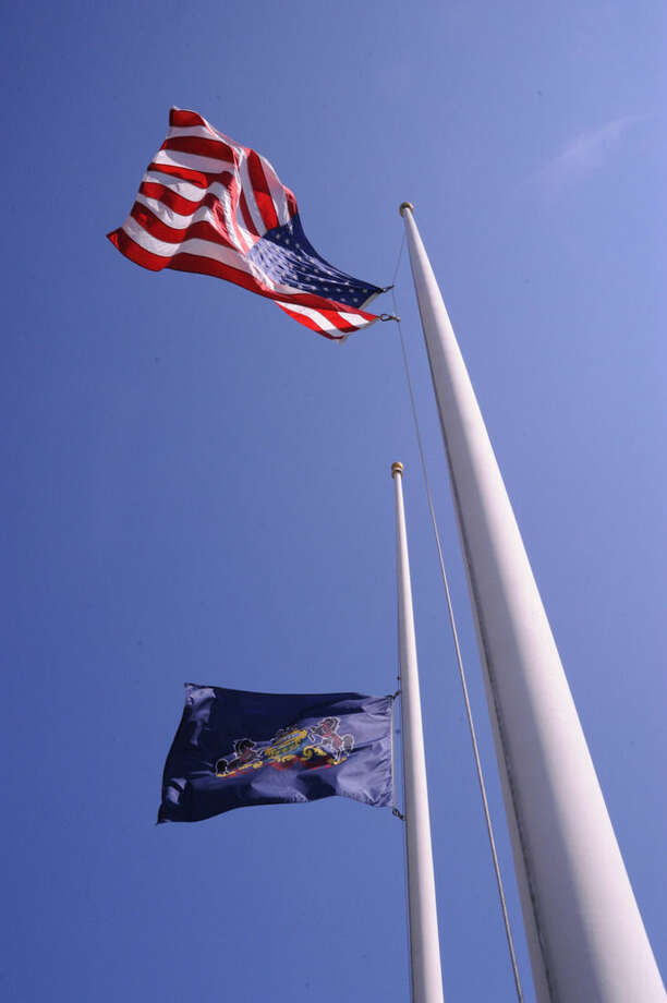 The American and Pennsylvania State flags fly at half-mast on Monday, Sept. 15, 2015, at the Pennsylvania State Police Barracks at Stonington for the late Corporal Bryan Dickson of Dunmore. Dickson was shot and killed outside of the barracks at Blooming Grove Township, Pa., on Friday night. Trooper Alex T. Douglas of Olyphant was also shot and injured in the ambush. (AP Photo/The News-Item, Mike Staugaitis)