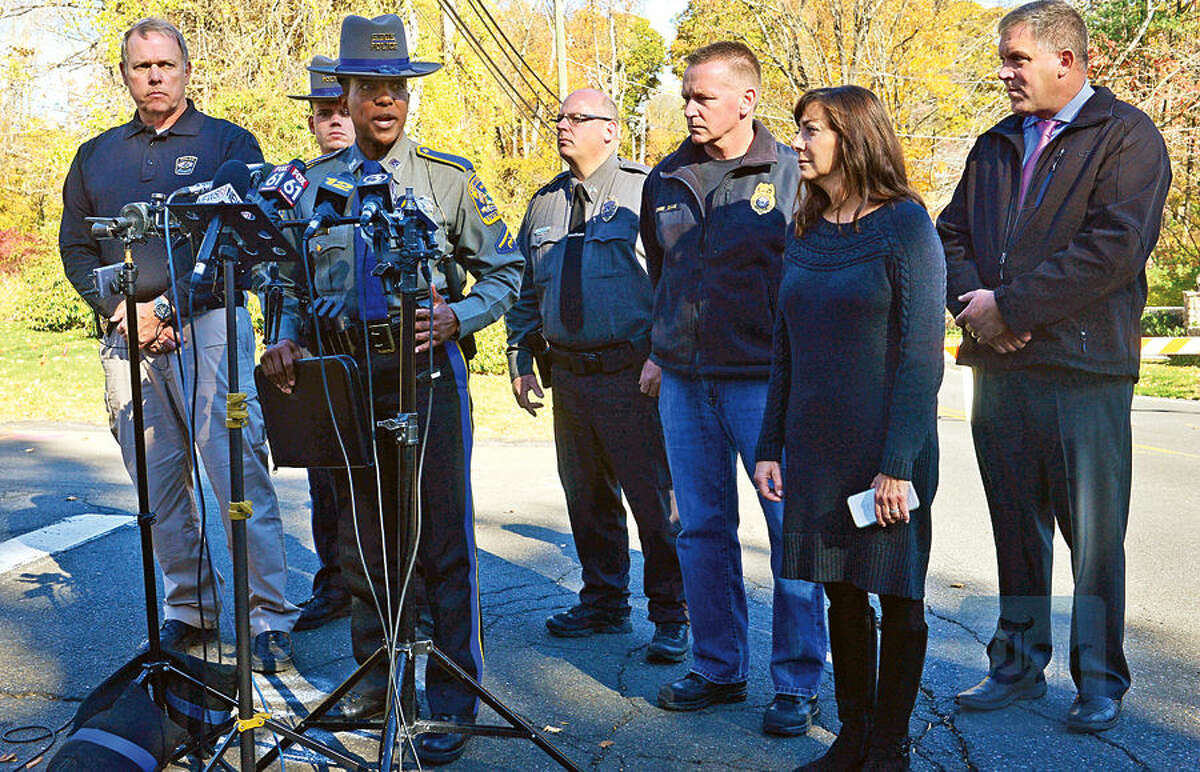 Hour photo / Erik Trautmann State Police Public Information Officer Kelly Grant holds a press conference with local officials on Norfield Road in Weston Friday after finding human remains at a vacant house there in connection with the ongoing investigation of a missing Easton couple, Janette and Jeffrey Navin.