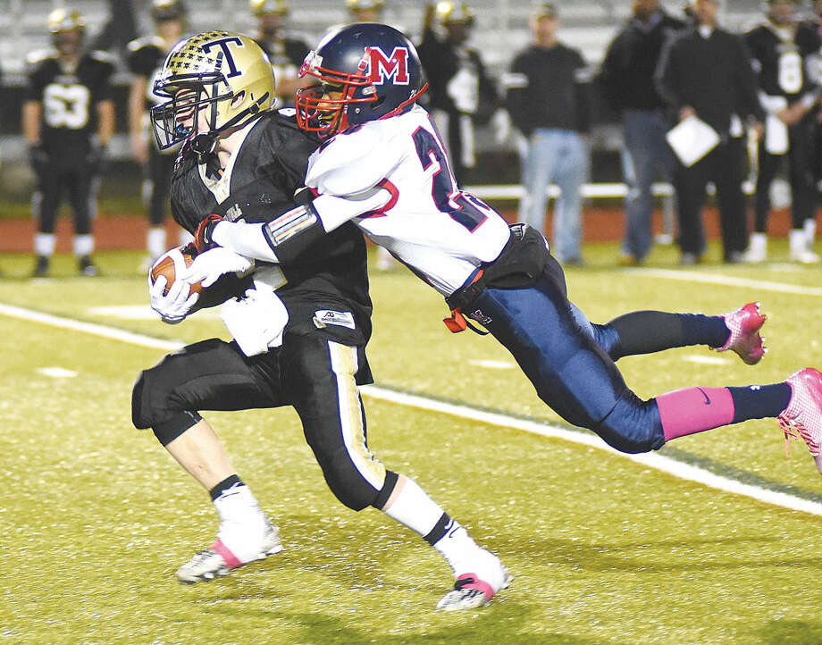 McMahon's Eric Day makes a tackle against Trumbull on Friday. (Hour photo/John Nash)