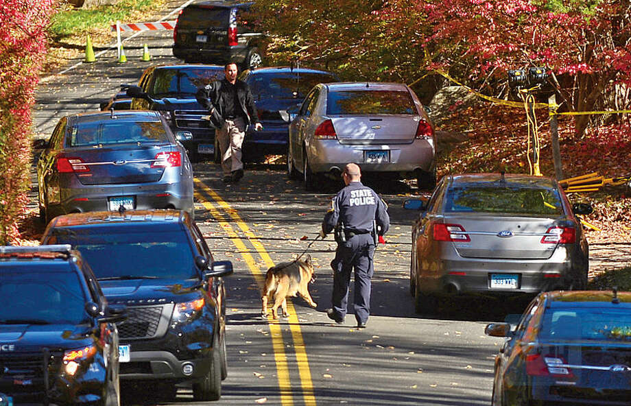 Hour photo / Erik Trautmann Local and state police close Norfield Road in Weston Friday after finding human remains at a vacant house there in connection with the ongoing investigation of a missing Easton couple, Janette and Jeffrey Navin.