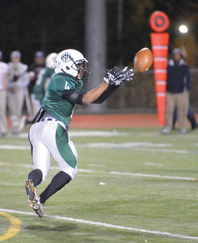 Hour Photo/Alex von Kleydorff Norwalk's #4 Deandre Russell catches a pass vs New Canaan