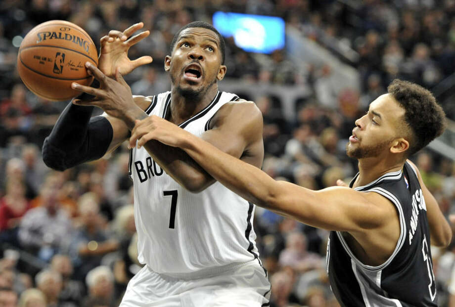 Brookly Nets forward Joe Johnson, left, is defended by San Antonio Spurs forward Kyle Anderson in the first half of an NBA basketball game Friday, Oct. 30, 2015, in San Antonio. (AP Photo/Bahram Mark Sobhani)
