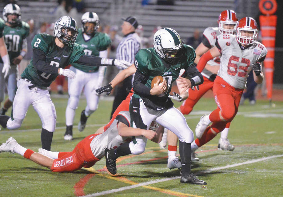 Hour Photo/Alex von Kleydorff Norwalk's #8 Krishtjan Frrokaj runs vs New Canaan