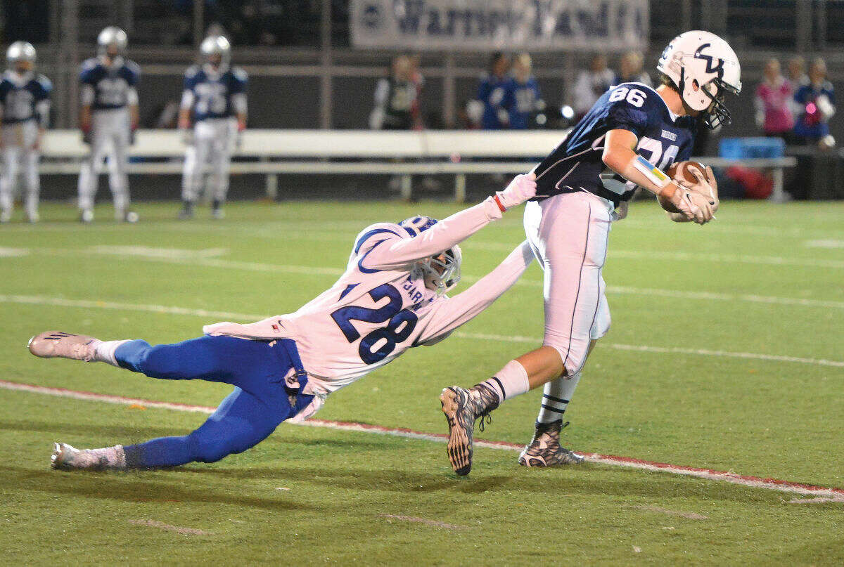 Hour Photo/Alex von Kleydorff Wiltons #86 Roger Hermann catches a pass and and makes yardage vs Darien