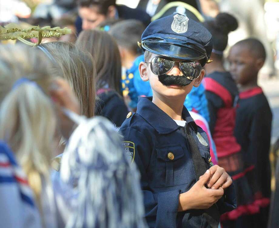 Hour Photo/Alex von Kleydorff 1st grader Sam Pavia grew his moustache upside down to make sure of the law and order during the Rowayton Elementary School's Halloween parade