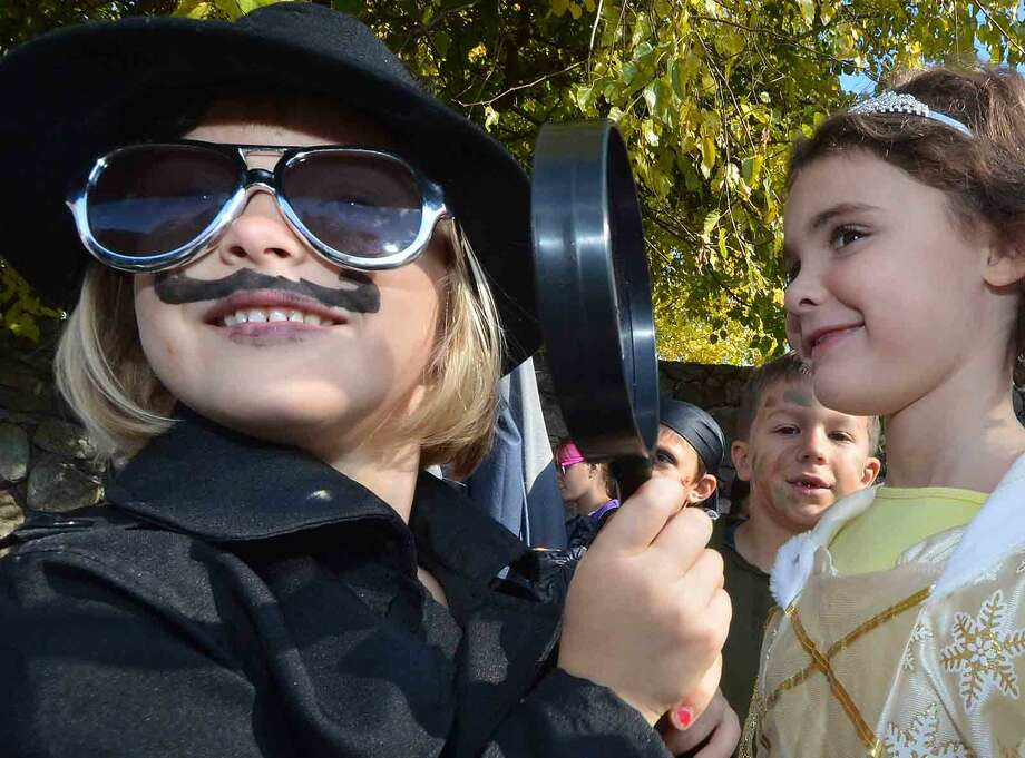 Hour Photo/Alex von Kleydorff 1st grader Phoebe Strickland has her eye on her classmates during the Rowayton Elementary School's Halloween parade