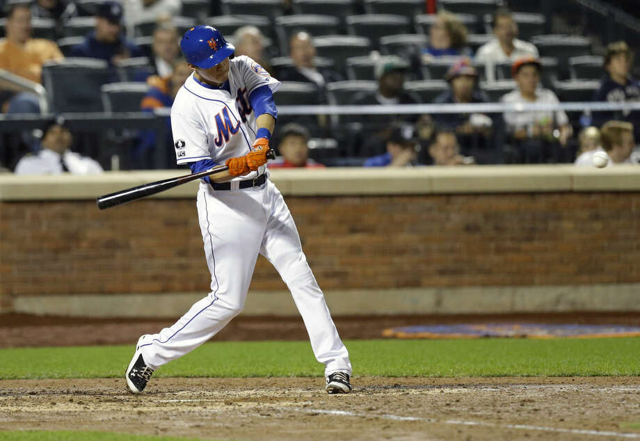 New York Mets' Wilmer Flores (4) hits a two run home run during the seventh inning of a baseball game against the Miami Marlins Tuesday, Sept. 16, 2014, in New York. (AP Photo/Frank Franklin II)