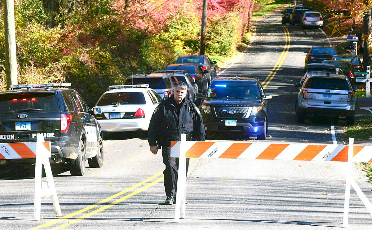 Hour photo / Erik Trautmann Weston and state police close off Norfield Road in connection with the disappearance of an Easton couple.