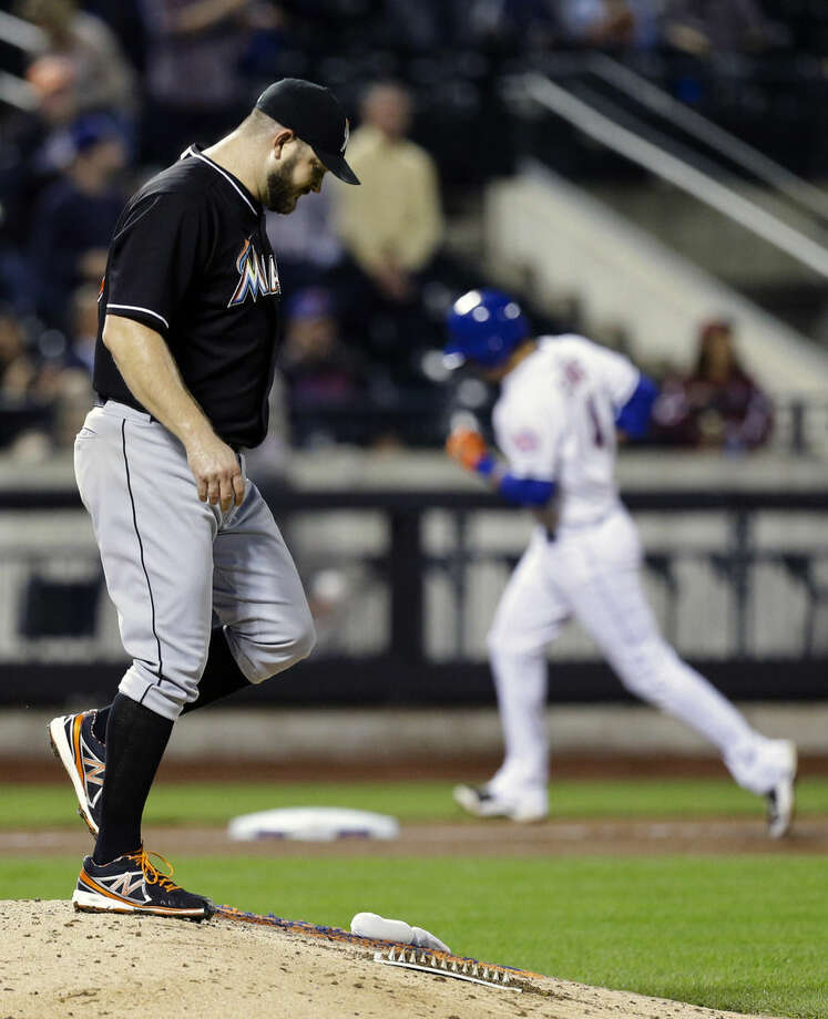 Miami Marlins starting pitcher Brad Penny (33) reacts as New York Mets' Wilmer Flores (4) runs the bases after hitting a two run home run during the seventh inning of a baseball game Tuesday, Sept. 16, 2014, in New York. (AP Photo/Frank Franklin II)