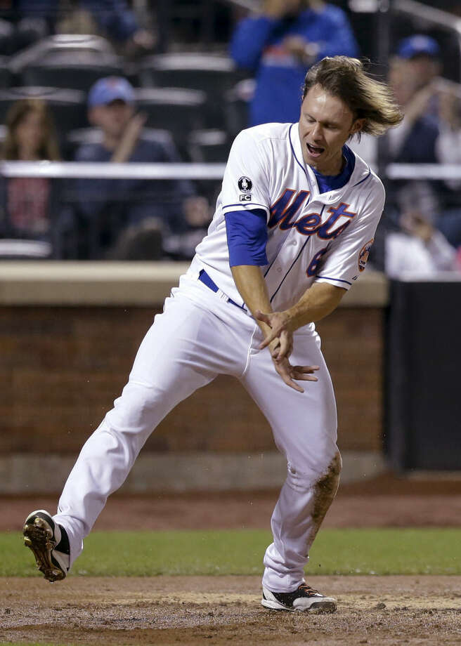 New York Mets' Matt den Dekker celebrates after scoring on an RBI double by Ruben Tejada during the fourth inning of a baseball game against the Miami Marlins Tuesday, Sept. 16, 2014, in New York. (AP Photo/Frank Franklin II)