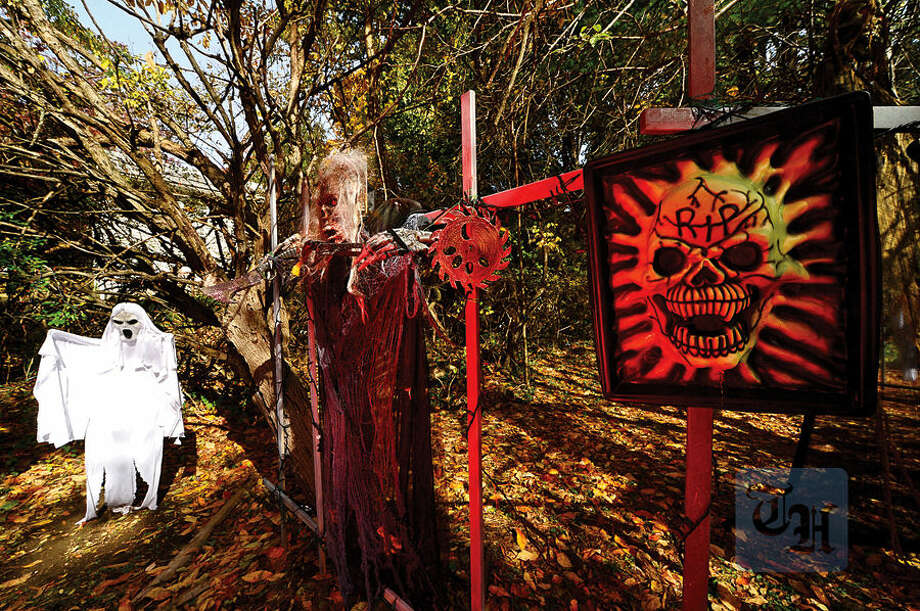 Hour photo / Erik Trautmann Norwalk residents, Jeannie and Bob Lamp, have put up a huge Halloween display in her yard at 4 Ledgewood Court again this year hoping to attract even more Trick-Or-Treaters.