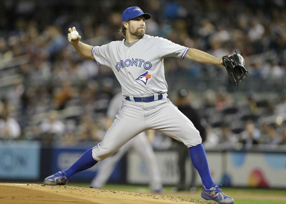 Toronto Blue Jays' R.A. Dickey delivers a pitch during the first inning of a baseball game against the New York Yankees Thursday, Sept. 18, 2014, in New York. (AP Photo/Frank Franklin II)