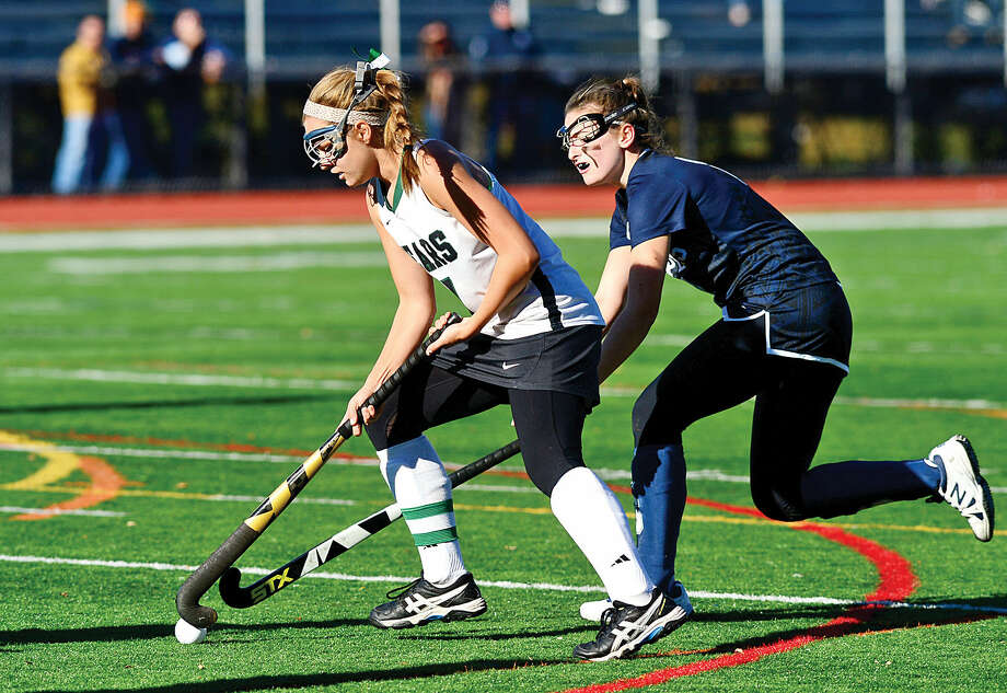 Hour photo / Erik Trautmann Norwalk High School Field Hockey captain Sarah Roddy takes the ball past Staples' Phoebe Mendelson in their quarter final game in Norwalk Saturday.