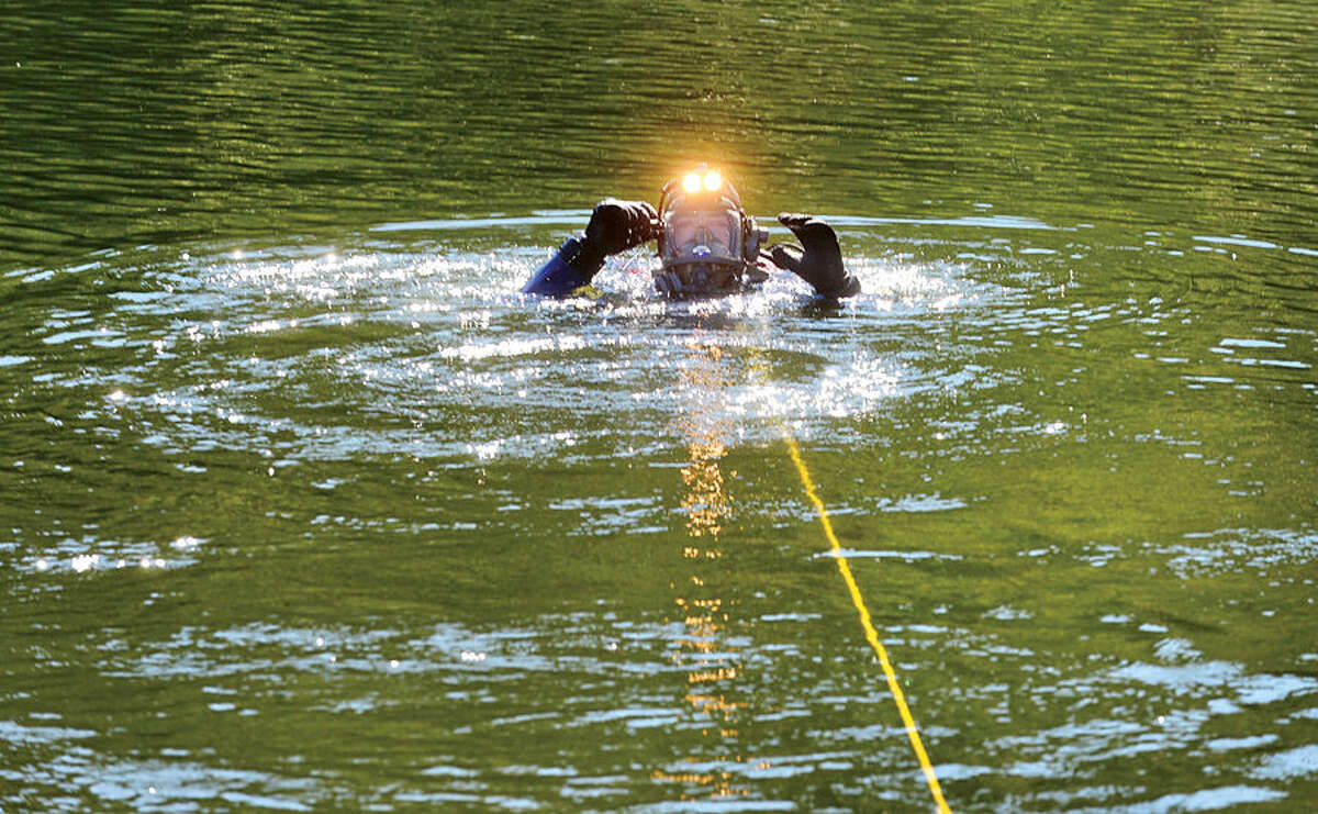 Wilton and Westport police and fire departments conduct water rescue training with their dive units in Wilton.