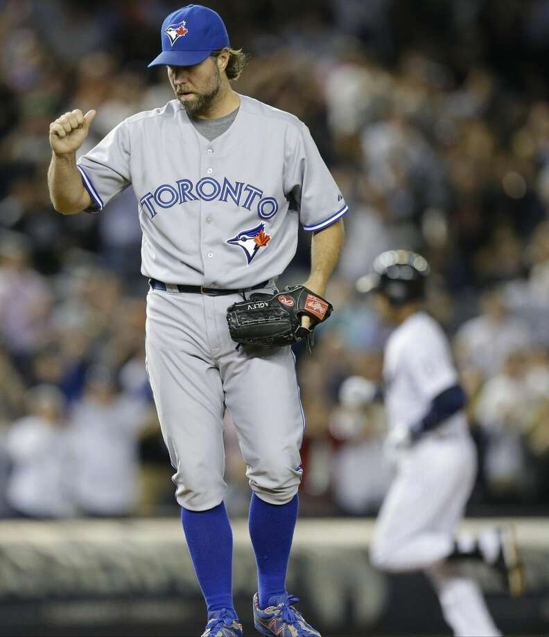 Toronto Blue Jays starting pitcher R.A. Dickey reacts as New York Yankees' Derek Jeter runs the bases after hitting a home run during the sixth inning of a baseball game Thursday, Sept. 18, 2014, in New York. (AP Photo/Frank Franklin II)