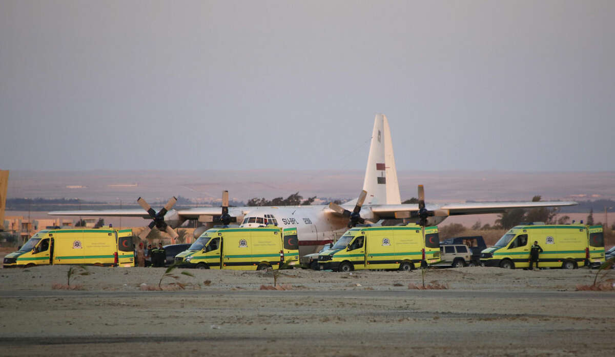 Ambulances line up as emergency workers unload bodies of victims from the crash of a Russian aircraft over the Sinai peninsula at the Kabrit military airport, some 20 miles north of Suez, Egypt, Saturday, Oct. 31, 2015. A Russian Metrojet plane crashed Saturday morning in a mountainous region in the Sinai after taking off from Sharm el-Sheikh, killing all 224 people aboard. Officials said the pilot had reported a technical problem and was looking to make an emergency landing before radio contact with air traffic controllers went dead. (AP Photo/Amr Nabil)