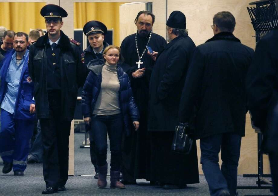 Police officers control the situation as relatives and the friends of those on the Metrojet flight that crashed in Egypt gather to grieve at a hotel near St. Petersburg's Pulkovo airport outside St.Petersburg, Russia, Saturday, Oct. 31, 2015. Russia's civil air agency is expected to have a news conference shortly to talk about the Russian Metrojet passenger plane that Egyptian authorities say has crashed in Egypt's Sinai peninsula. (AP Photo/Dmitry Lovetsky)