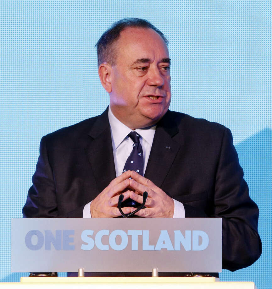 Scottish First Minister Alex Salmond speaks during a press conference in Edinburgh, Scotland, Friday, Sept. 19, 2014. Scottish voters have rejected independence and decided that Scotland will remain part of the United Kingdom. The result announced early Friday was the one favored by Britain's political leaders, who had campaigned hard in recent weeks to convince Scottish voters to stay. It dashed many Scots' hopes of breaking free and building their own nation. (AP Photo/PA, Danny Lawson) UNITED KINGDOM OUT, NO SALES, NO ARCHIVE