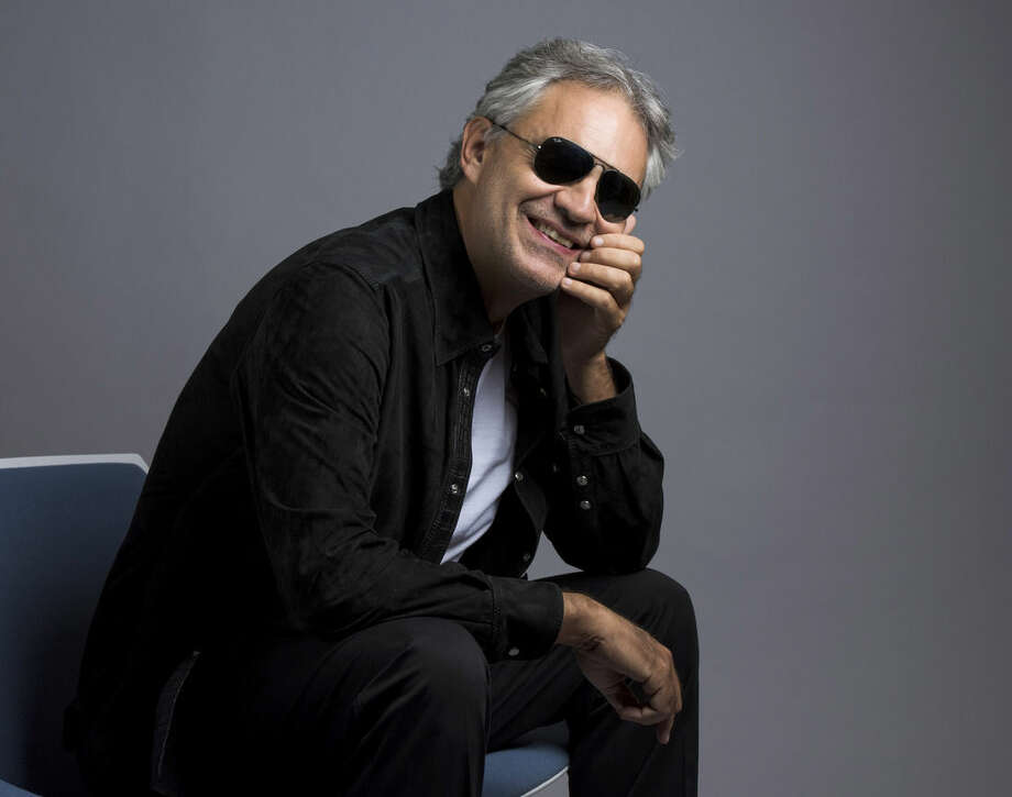 "In this Oct. 29, 2015 photo, Andrea Bocelli poses for a portrait in New York. Bocelli has released an album, ""Cinema,"" which includes a duet with pop star Ariana Grande. (Photo by Drew Gurian/Invision/AP)"