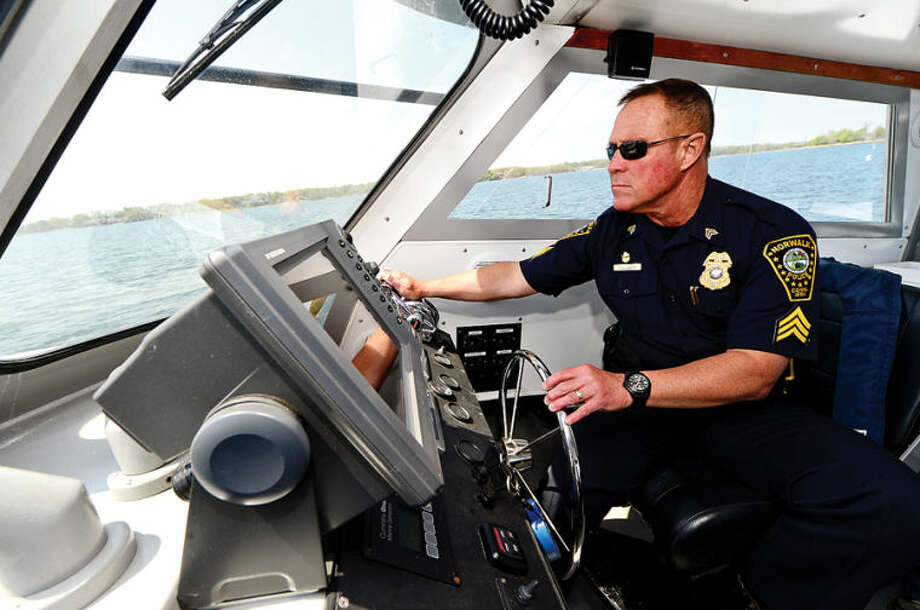 Hour photo / Erik Trautmann Sgt. Peter Lapak has served in the Norwalk Police Department Marine Unit for the past 25 years.