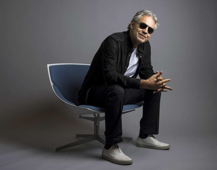 """In this Oct. 29, 2015 photo, Andrea Bocelli poses for a portrait in New York. Bocelli has released an album, """"Cinema,"""" which includes a duet with pop star Ariana Grande. (Photo by Drew Gurian/Invision/AP)"""