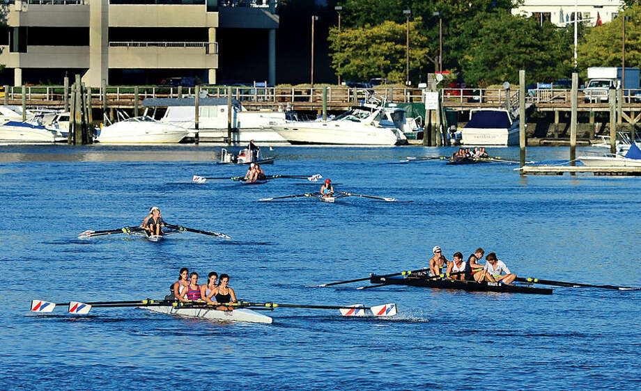 Hour photo / Erik Trautmann Rowing clubs take to the water on the Norwalk River Friday.