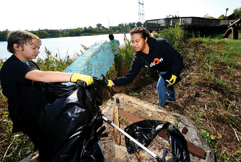 Hour photo / Erik Trautmann Ann Siefken and Ruth Padilla of Build On remove trash from the Norwalk River at Oyster Shell Park Saturdaynas part of the International Coastal Cleanup coordinated in Connecticut by Save the Sound. Save the Sound hosted 17 public coastal cleanups including one at Oyster Shell Park Saturday.