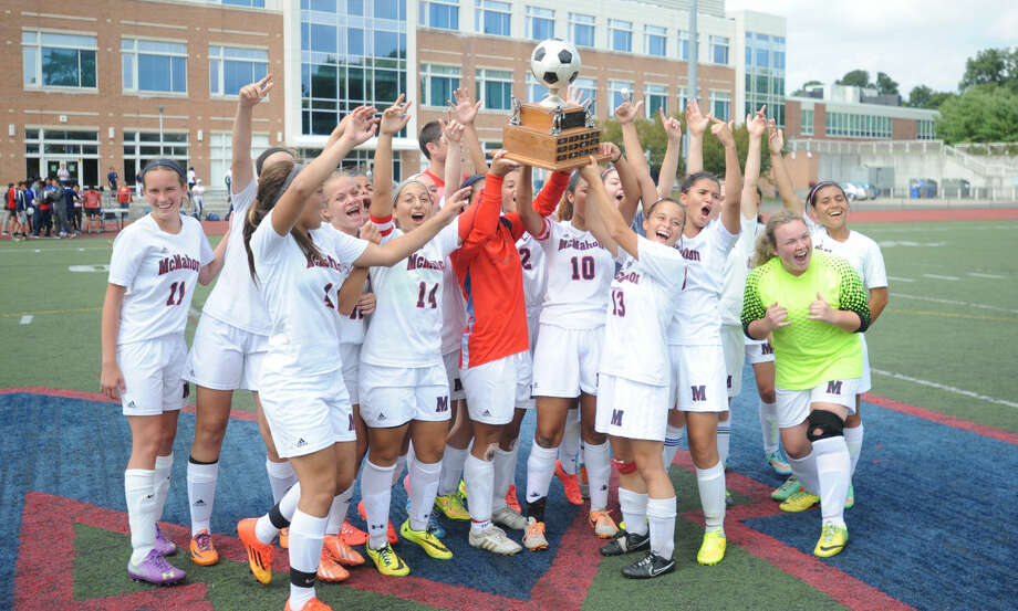 The Brien McMahon girls soccer team celebrates its 3-0 win over Norwalk on Saturday.
