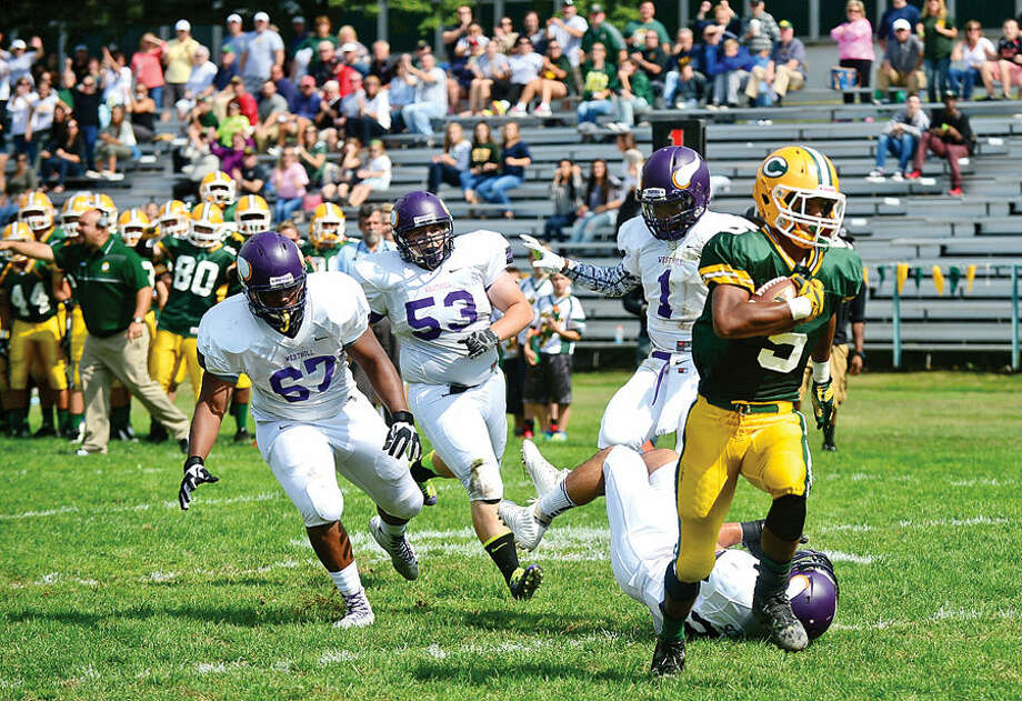 Hour photo / Erik Trautmann Crusader #5 Randy Polonia heads toward the endzone during their game against Westhill at Trinity Catholic High School Saturday.