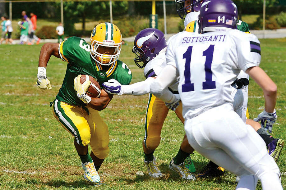 Hour photo / Erik Trautmann Crusader #3 Coutlyn Victrum looks for yardage during their game Westhill at Trinity Catholic High School Saturday.