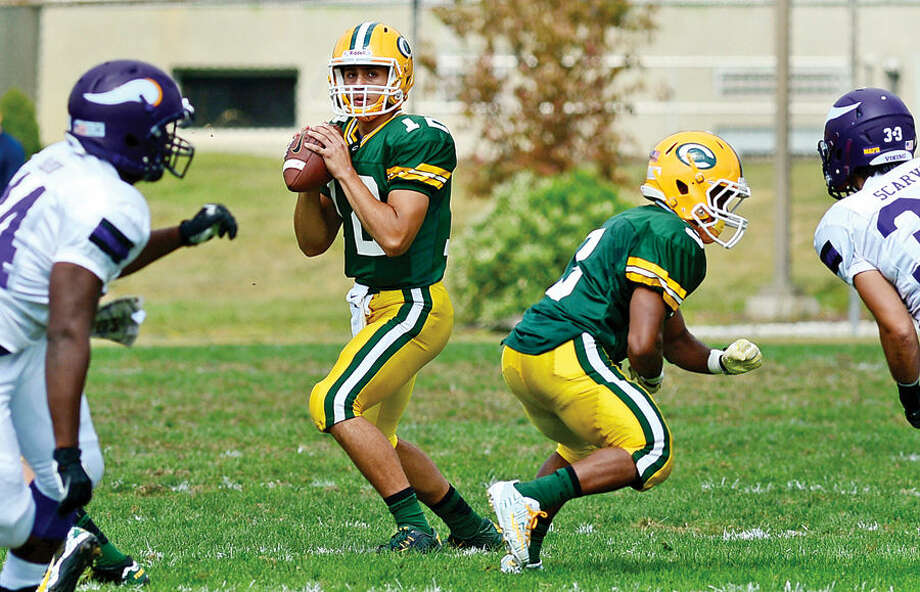 Hour photo / Erik Trautmann Crusader QB Anthony Lombardi looks to pass during their game against Westhill at Trinity Catholic High School Saturday.