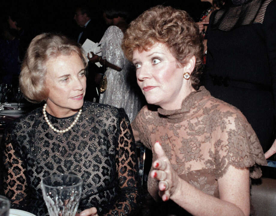 "FILE - In this Oct. 3, 1984, file photo, U.S. Supreme Court Justice Sandra Day O'Connor, left, speaks with actress Polly Bergen at a National Women's Forum dinner in Washington. Bergen, an Emmy-winning actress and singer, who in a long career played the terrorized wife in the original ""Cape Fear"" and the first woman president in ""Kisses for My President,"" died Saturday, Sept. 20, 2014, at her home in Southbury, Conn., publicist Judy Katz said. She was 84. (AP Photo/Ira Schwarz, File)"