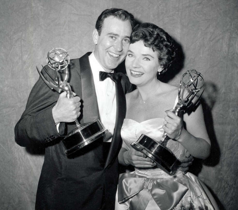 "FILE - In this April 15, 1958, file photo, writer Carl Reiner and actress Polly Bergen pose with their statuettes at the Emmy Awards presentations in New York. Reiner won for best continuing supporting performance by an actor in a dramatic or comedy series for ""Caesar's Hour."" Bergen won best single performance by an actress in a lead or support role for ""Playhouse 90: Helen Morgan Story."" Bergen, an Emmy-winning actress and singer, who in a long career played the terrorized wife in the original ""Cape Fear"" and the first woman president in ""Kisses for My President,"" died Saturday, Sept. 20, 2014, at her home in Southbury, Conn., publicist Judy Katz said. She was 84. (AP Photo/File)"