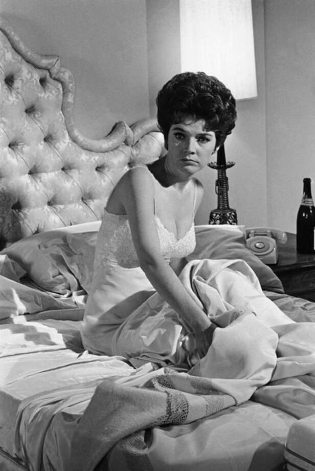 "FILE - In this July 18, 1963, file photo, actress Polly Bergen works on a scene during the filming of ""Move Over, Darling,"" in the Hollywood section of Los Angeles. Bergen, an Emmy-winning actress and singer, who in a long career played the terrorized wife in the original ""Cape Fear"" and the first woman president in ""Kisses for My President,"" died Saturday, Sept. 20, 2014, at her home in Southbury, Conn., publicist Judy Katz said. She was 84. (AP Photo/Don Brinn, File)"