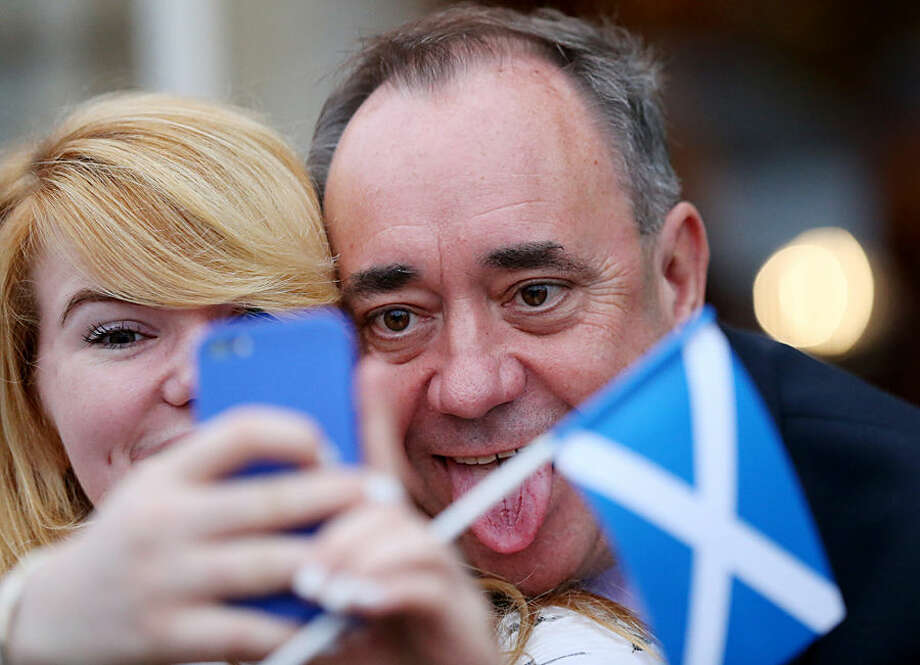 Scotland's First Minister Alex Salmond meets members of the public on a walkabout in Inverurie, Scotland, Thursday, Sept. 18, 2014. Polls opened across Scotland in a referendum that will decide whether the country leaves its 307-year-old union with England and becomes an independent state. (AP Photo/Scott Heppell)