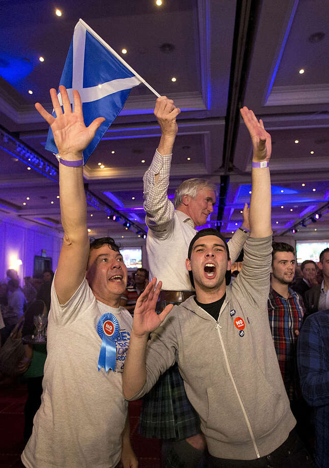 Supporters of the No campaign for the Scottish independence referendum celebrate after the final result was announced at a No campaign event at a hotel in Glasgow, Scotland, Friday, Sept. 19, 2014. Scottish voters have rejected independence and decided that Scotland will remain part of the United Kingdom. The result announced early Friday was the one favored by Britain's political leaders, who had campaigned hard in recent weeks to convince Scottish voters to stay. It dashed many Scots' hopes of breaking free and building their own nation. (AP Photo/Matt Dunham)