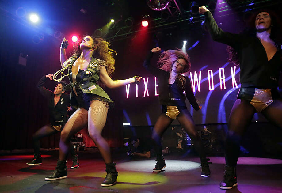 In this July 26, 2014 photo, Janet Jones, foreground left, leads a Vixen Workout fitness concert at the Highline Ballroom in New York. Jones, a former Miami Heat dancer, created the Vixen Workout two years ago after she lost her job as a financial assistant, and her high-energy routine has caught on in New York and other cities. (AP Photo/Richard Drew)