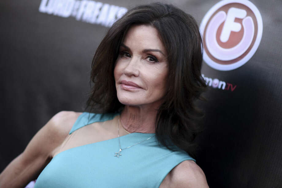 "FILE - In this June 29, 2015 file photo, Janice Dickinson arrives at the LA Premiere of ""Lord of the Freaks"" in Los Angeles. A judge says Bill Cosby and his former attorney should be deposed by lawyers for Janice Dickinson in the model's defamation lawsuit against the embattled comedian. Los Angeles Superior Court Judge Debre Katz Weintraub ruled that Dickinson's lawyers should depose Cosby and attorney Martin Singer before Nov. 25. Dickinson is suing Cosby for defamation over statements last year denying the comedian raped Dickinson in 1982. (Photo by Richard Shotwell/Invision/AP, File)"