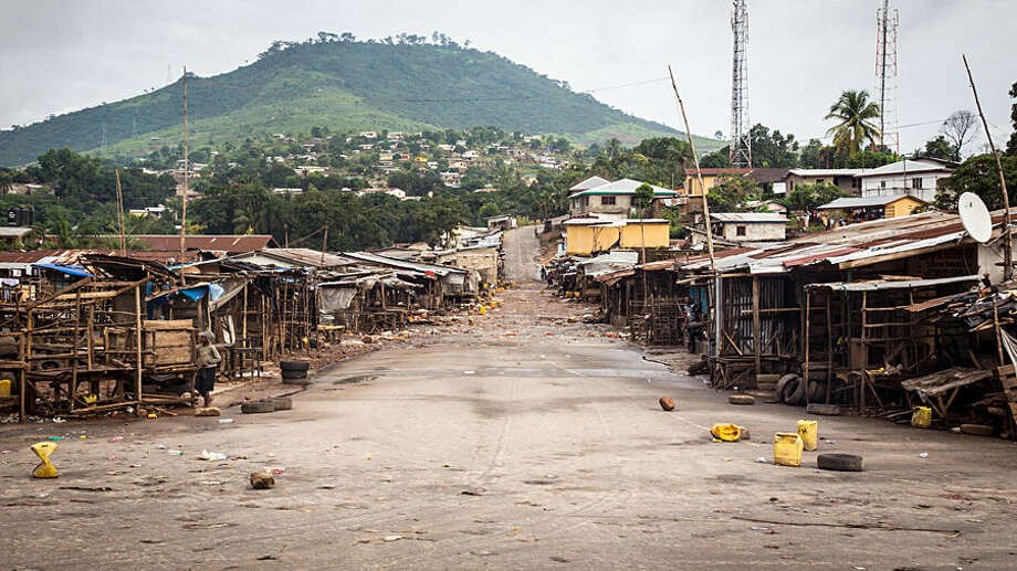 An empty local market area is seen, as Sierra Leone government enforces a three day lock-down on movement of all people in a attempt to fight the Ebola virus, in Freetown, Sierra Leone, Friday, Sept. 19, 2014. Thousands of health workers began knocking on doors across Sierra Leone on Friday in search of hidden Ebola cases with the entire West African nation locked down in their homes for three days in an unprecedented effort to combat the deadly disease. (AP Photo/ Michael Duff)