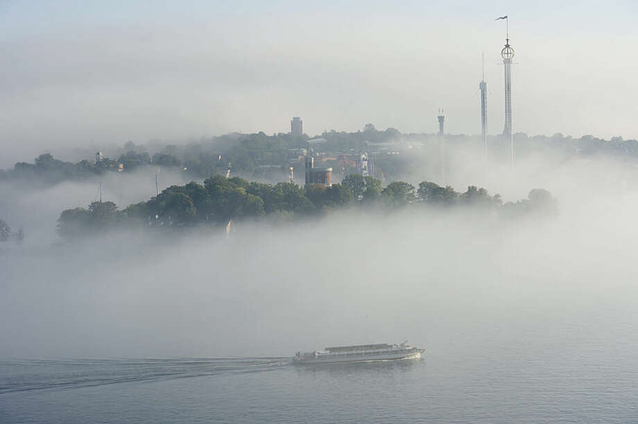 A sightseeing boat heads out through the early morning fog in the central harbour in Stockholm Thursday Sept. 18, 2014. (AP Photo/Fredrik Sandberg) SWEDEN OUT