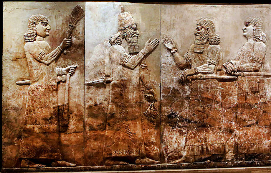 This Monday, Sept. 15, 2014 photo shows, bas-relief displayed at the Iraqi National Museum in Baghdad. For more than 5,000 years, numerous civilizations have left their mark on upper Mesopotamia _ from Assyrians and Akkadians to Babylonians and Romans. Their ancient, buried cities, palaces and temples packed with monumental art are scattered across what is now northern Iraq and eastern Syria. Now much of that archaeological wealth is under the control of extremists from the Islamic State group. They have already destroyed some of that heritage in their zealotry to uproot what they see as heresy. (AP Photo/Hadi Mizban)