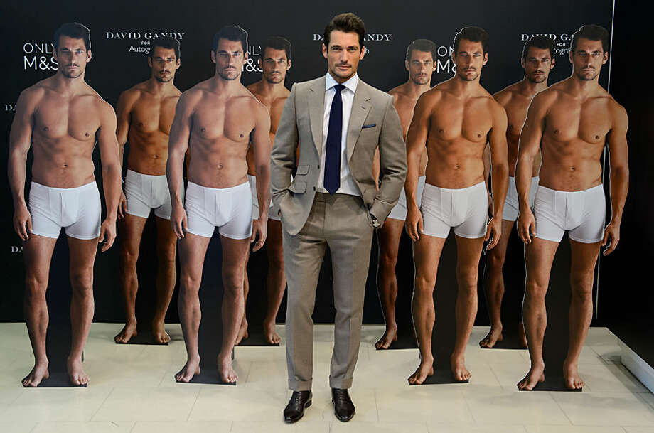 British model David Gandy poses for photographers to launch his new clothing range at a central London venue, London, Thursday, Sept. 18, 2014. (Photo by Jonathan Short/Invision/AP)