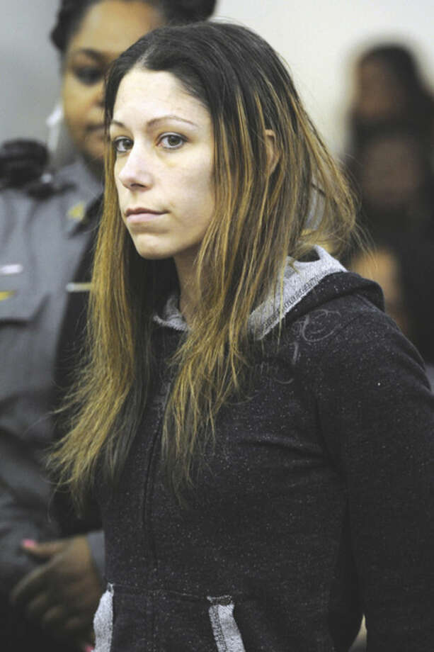 Ned Gerard/Hearst Connecticut Media via AP, PoolJennifer Valiante is arraigned in Bridgeport Superior Court, in Bridgeport Monday. Valiante is charged with conspiracy to commit murder in connection with the deaths of Jeanette and Jeffrey Navin. Their son, Kyle Navin, has been arrested for their murders.