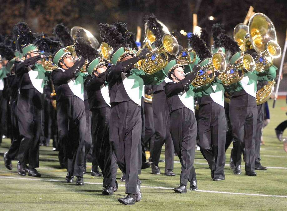 Hour Photo/Alex von Kleydorff Norwalk High School's marching Bears perform Cry of the Valkyrie during halftime at Friday nights football game