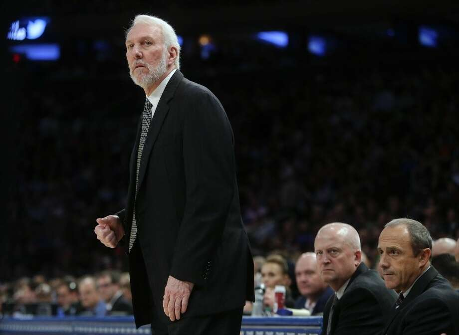 San Antonio Spurs head coach Gregg Popovich watches his team play during the first half of an NBA basketball game against the New York Knicks, Monday, Nov. 2, 2015, in New York. (AP Photo/Frank Franklin II)