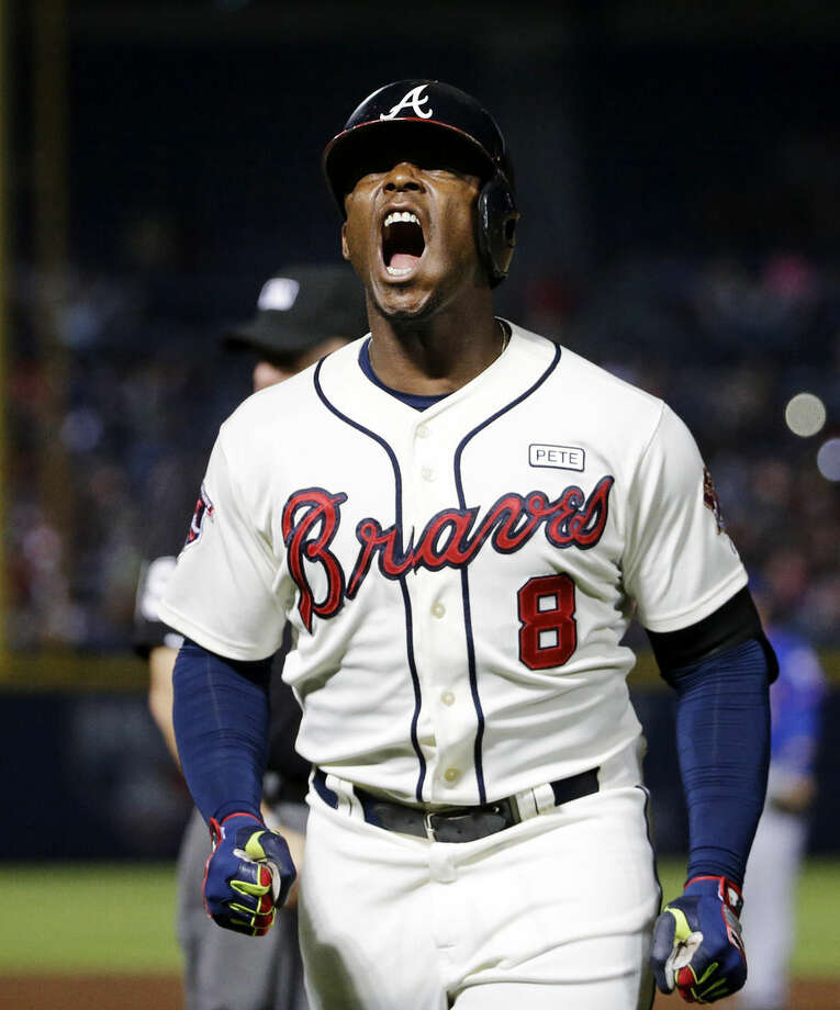 Atlanta Braves' Justin Upton reacts after grounding out in the eighth inning of a baseball game against the New York Mets, Saturday, Sept. 20, 2014, in Atlanta. (AP Photo/David Goldman)
