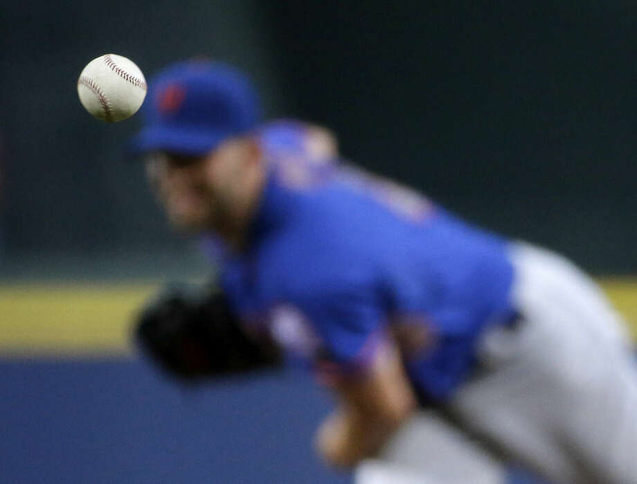 The ball is thrown by New York Mets starting pitcher Jonathon Niese in the first inning of a baseball game against the Atlanta Braves, Saturday, Sept. 20, 2014, in Atlanta. (AP Photo/David Goldman)