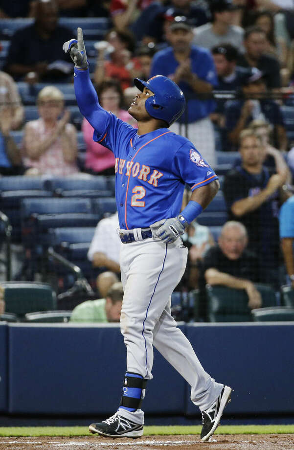 New York Mets' Dilson Herrera points to the sky as he crosses home plate after hitting a two-run home run to score teammate Eric Campbell in the second inning of a baseball game against the Atlanta Braves, Saturday, Sept. 20, 2014, in Atlanta. (AP Photo/David Goldman)