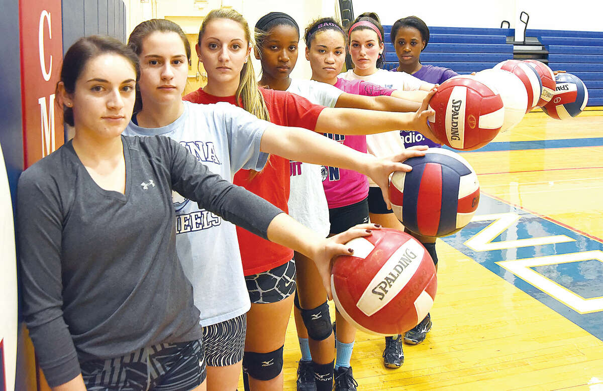 Key reserves for the Brien McMahon volleyball team, which is playing in the FCIAC playoffs for the first time since 1986, include, from left, junior Lilly Raffio, sophomores Savanna Buzzeo and Kathleen Downey, juniors Jennifer Bouzy and Erickah Montgomery, sophomore Liz Murphy and junior Clairdene Jean-Baptiste. (Hour photo/John Nash)